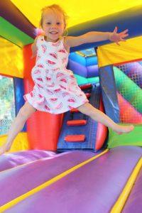 kid in bouncy castle