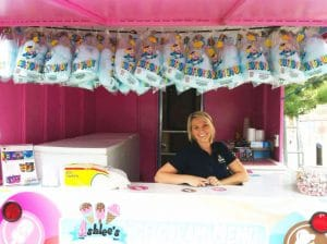 Ashlee at a booth