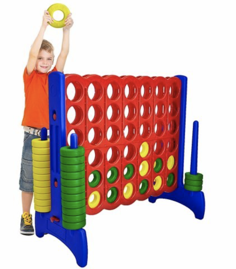 kid playing with giant connect four